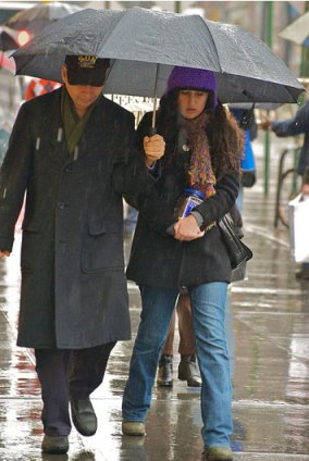 """Friends share their umbrella ... especially if it's a big one."" Photo: Ed Yourdan, Dec. 2009"